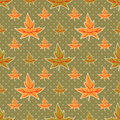 Seamless autumn leaves pattern on dotted green background Royalty Free Stock Photography