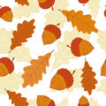 Seamless autumn pattern with acorns and oak leaves. Royalty Free Stock Photo