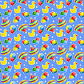 Seamless baby toys background wallpaper or repeat pattern with colorful spinning tops rubber ducks and building blocks and blue Royalty Free Stock Photo