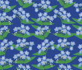 Seamless background with blue flowers Stock Photography