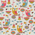 Seamless background bright with cute owls and flowers in cartoon style Royalty Free Stock Photography