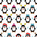 Seamless background with Christmas decorative penguins.