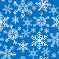Seamless background with christmas snowflakes a Royalty Free Stock Photos
