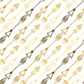 Seamless background of ethnic arrow in gold colors. Hand drawn arrows vector pattern. Royalty Free Stock Photo