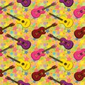 Seamless background guitars pattern of colorful and stars Stock Photography