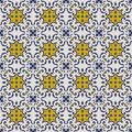 Seamless background image of vintage blue green yellow kaleidoscope pattern. Royalty Free Stock Photo