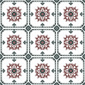 Seamless background image of vintage green round frame red spiral flower pattern tile. Royalty Free Stock Photo