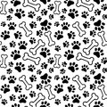 Seamless background pet paw print and bone vector bones Royalty Free Stock Photos