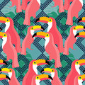 Seamless background. Pink toucans on a tropical background.