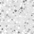 Seamless background with scattering of grey hearts