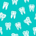 Seamless background with symbols of teeth
