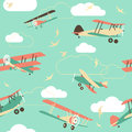 Seamless background of vintage airplanes in retro style with birds and clouds Royalty Free Stock Photos