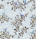 Seamless blue background or wallpaper with branches and birds Royalty Free Stock Images