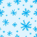 Seamless blue snowflakes texture with negligent on the Royalty Free Stock Photos