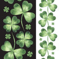 Seamless borders made of watercolor vector clover leaves