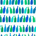Seamless bottle pattern with blue glass wine bottles Royalty Free Stock Photos