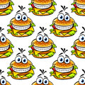 Seamless cartoon cheeseburger pattern with a double helping of cheese and a large toothy smile in a repeat motif Royalty Free Stock Photos