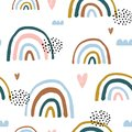 Seamless childish pattern with hand drawn rainbows and hearts, .Creative scandinavian kids texture for fabric, wrapping, textile,