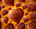 Seamless chocolate hearts background Stock Images