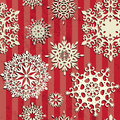 Seamless christmas background snowflakes on retro red backdrop Royalty Free Stock Photo