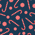 Seamless Christmas pattern with candy cane and lollipop.