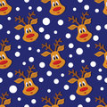 Seamless Christmas pattern with deer and snowflakes on blue background.