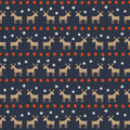 Seamless christmas pattern deers stars and snowflakes happy new year background vector design for winter holidays on dark blue Stock Photos