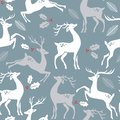 Deer on blue background with hole berries and leaves.
