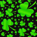 Seamless clover pattern on patrick s day black background at Stock Photos