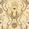 Seamless color pattern: human hands support a palm with an all-seeing eye. Esoteric, mysticism, occultism. Royalty Free Stock Photo