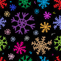 Seamless color snowflakes black texture with multi colored negligent on the Stock Photography
