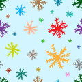 Seamless color snowflakes on blue texture with multi colored negligent the Stock Image
