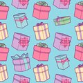Seamless colorful cartoon birthday party pattern with wrapped gift boxes with ribbons on light blue background
