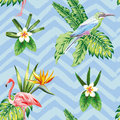 Seamless composition of tropical bird flowers and plants blue zi