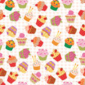 Seamless cupcakes pattern made of yummy Royalty Free Stock Image