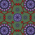 Seamless decorative mandala pattern with floral, geometric ornament design in red, green and purple color. traditional ethnic