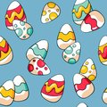 Seamless Easter pattern with colourful eggs on blue background. Hand drawn doodle Easter eggs. Cartoon eggs background.