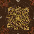 Seamless ethnic pattern with the mandala on a dark brown background Stock Image