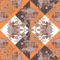 Seamless ethnic pattern in orange, brown, white, black and grey colors with hearts and flowers.