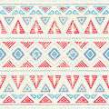 Seamless ethnic pattern. Ornament in tribal style. Grunge texture. Vintage print. Red, white and blue geometric elements. Royalty Free Stock Photo