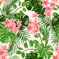 Seamless exotic pattern with tropical leaves and flowers. Royalty Free Stock Photo