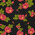 Seamless floral ornament with wild rose on a polka dot background Royalty Free Stock Photo