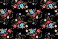 Seamless floral pattern with bouquets of bright flowers isolated on black background in folk style. Vector summer design