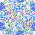 A seamless floral pattern with the bouquets of Hydrangea flowers, blue roses and leaves, painted in a watercolor on a white backgr Royalty Free Stock Photo