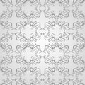 Seamless floral pattern elegant grey decorative background wallpaper print swatch with stylized swirls and leaves Stock Photo