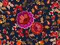Seamless floral pattern in russian folk style. Beautiful bunch of flowers and paisley on dark blue background