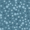 Seamless floral pattern. Small flowers and leaves. Blue shades.