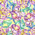 A seamless floral pattern with the watercolor violet and yellow exotic flowers and blue and green leaves
