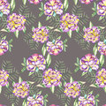 Seamless floral pattern with the watercolor violet and yellow exotic flowers and green leaves