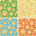 Seamless four-color flowers Stock Images